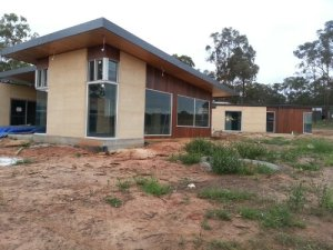 Rammed Earth is an excellent low carbon, humidity regulating thermal mass that works well with solar passive design.