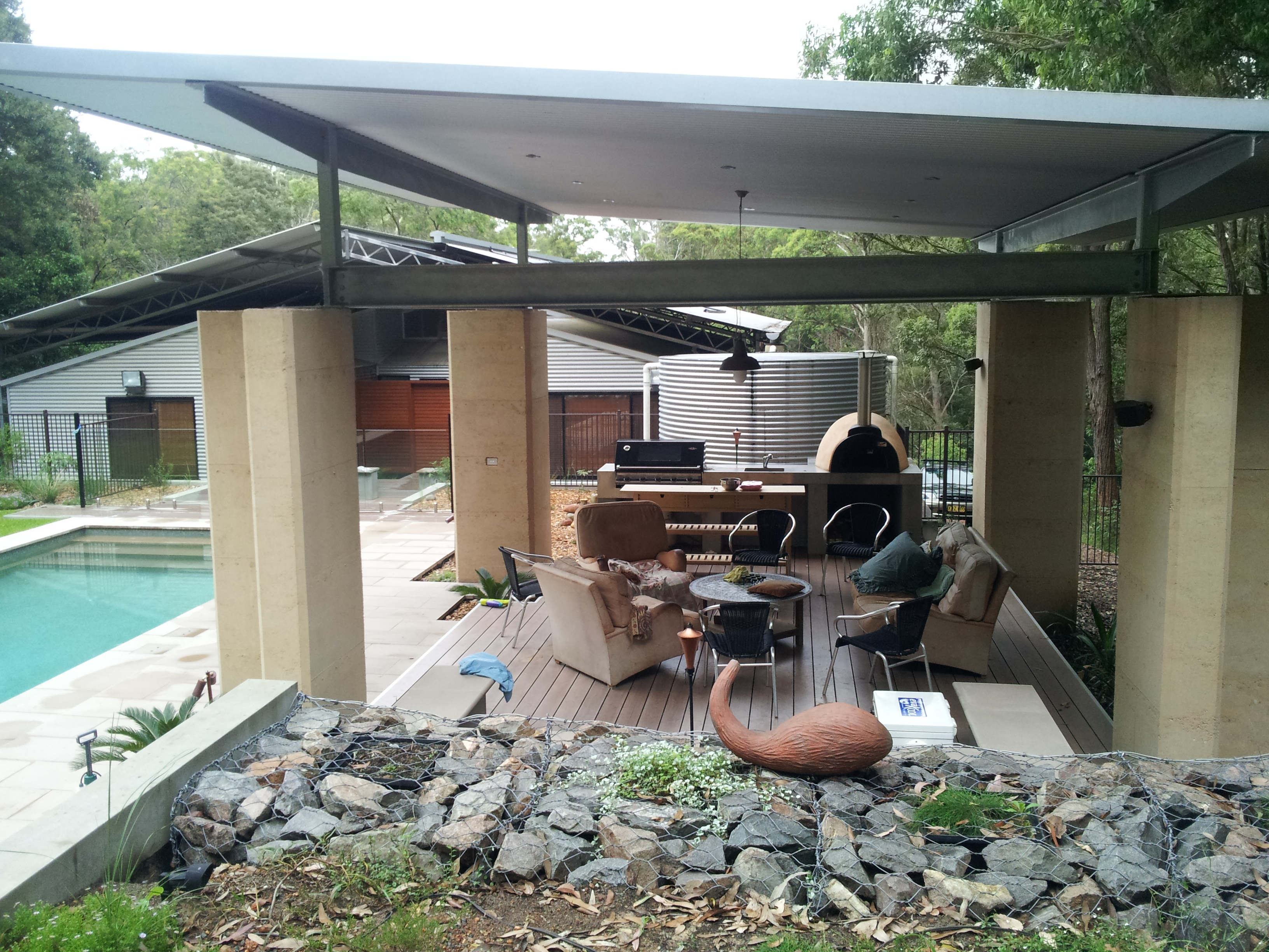Rammed earth pool shelter in newcastle hunter valley for Pool design newcastle